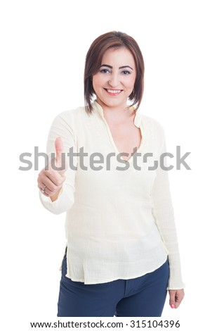 Casual woman showing like or thumb-up gesture and smiling standing isolated on white - stock photo