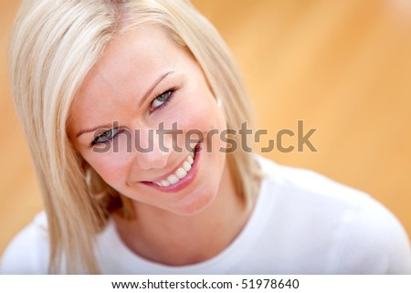 casual woman smiling and relaxing at home