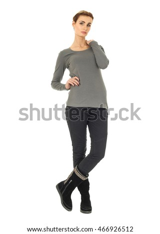 Casual woman standing isolated over a white