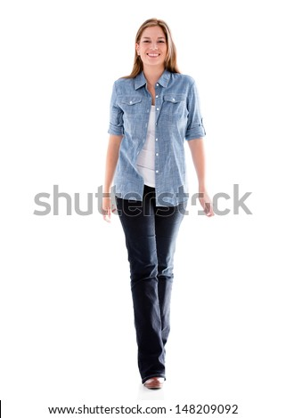 Casual woman walking and smiling - isolated over white background  - stock photo