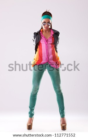 casual woman wearing leather jacket and high heels posing for the camera - stock photo