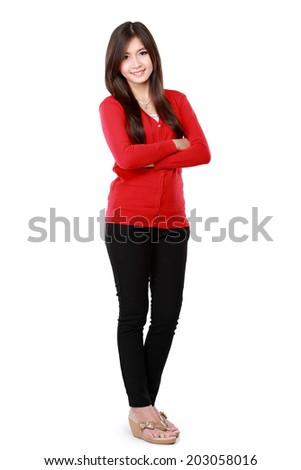 Casual woman with arms crossed and looking at camera isolated over white background - stock photo