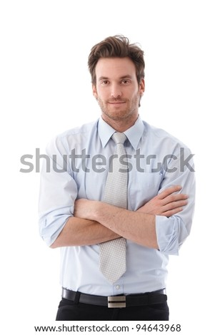 Casual young businessman standing arms crossed, smiling.? - stock photo