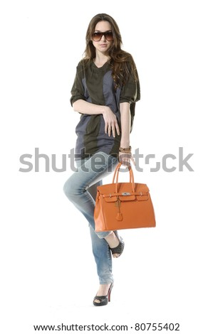 casual young fashion mode in sunglasses with handbag show in studio - stock photo