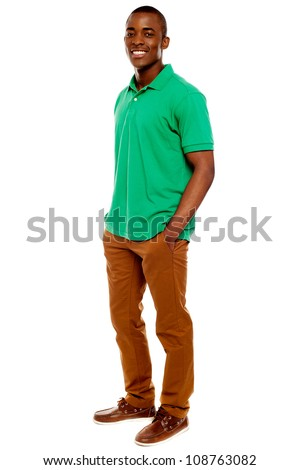 Casual young guy posing with hands in pocket isolated on white background