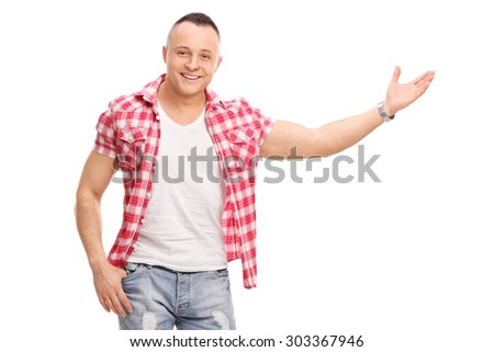 Casual young man gesturing with his hand and looking at the camera isolated on white background