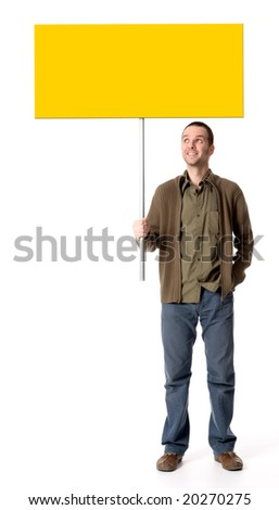 Casual young man holding a placard / sign, looking up at the sign - stock photo