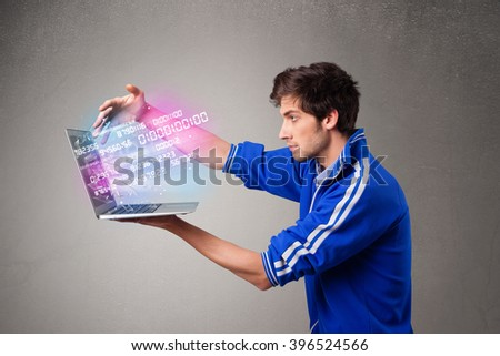 Casual young man holding laptop with exploding data and numbers