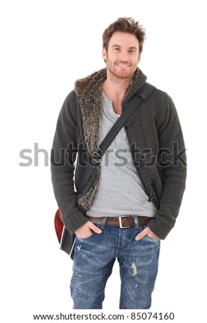 Casual young man in jeans and cardigan smiling over white background.? - stock photo