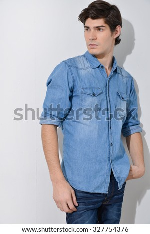 Casual young man in jeans â??gray background - stock photo