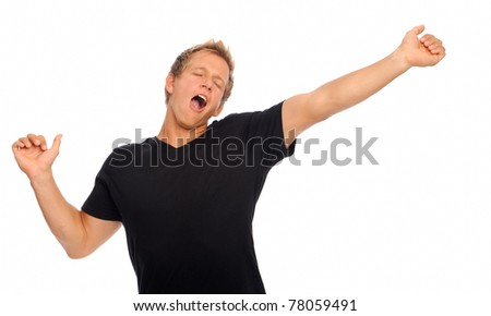 Casual young man is so sleepy he stifles a yawn in studio, isolated on white - stock photo