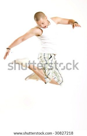 casual young man jumps in the air