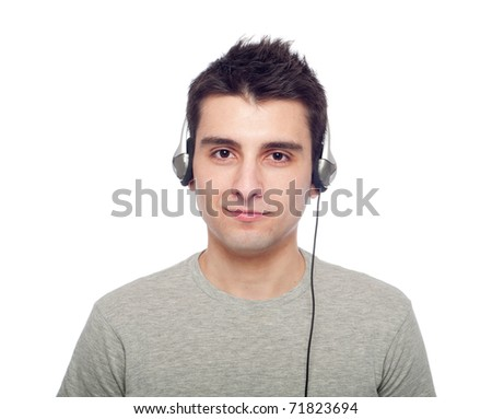 casual young man listening music on headphones (isolated on white background) - stock photo