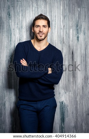Casual young man looking at camera and smiling. Men's beauty.  - stock photo