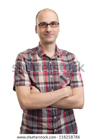 Casual young man looking at camera with arms crossed. Isolated on white background - stock photo