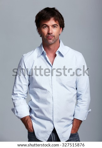 Casual young man portrait. over grey background. - stock photo