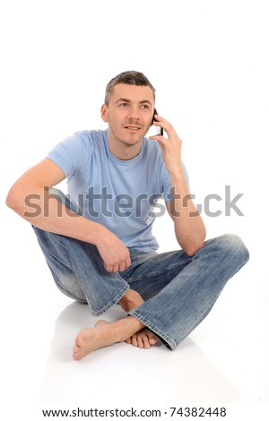casual young man speaking on the mobile phone. isolated - stock photo