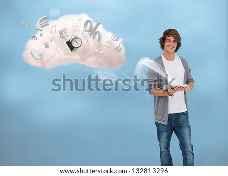 Casual young man using tablet for cloud computing accessing many applications