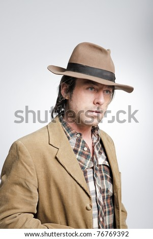 Casual young man wearing hat. Studio portrait.