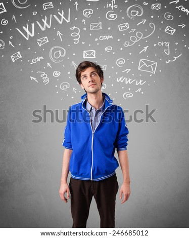 Casual young man with abstract white media icon doodles on gradient background - stock photo