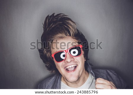 casual young man with sunglasses shaking his head - stock photo
