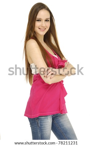 casual young woman in blue jeans smiling posing - stock photo