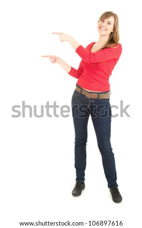 Casual young woman pointing up, full length, white background
