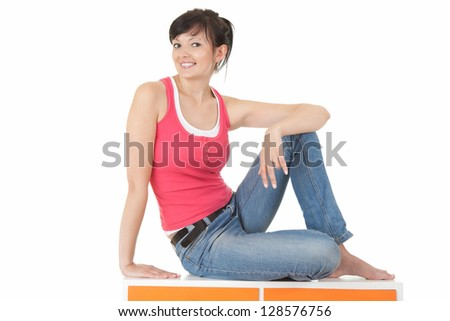 casual young woman smiling, full lenght, white background - stock photo