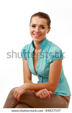Casual young woman smiling isolated on white background - stock photo