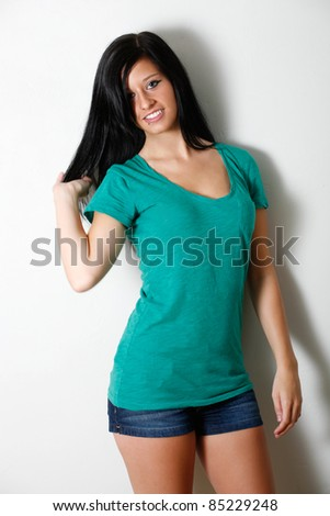 Casual young woman wall pose - stock photo