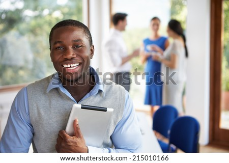 Casually Dressed Businessman Attending Meeting In Boardroom - stock photo