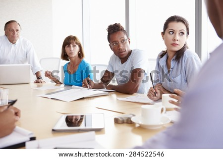 Casually Dressed Businesspeople Having Meeting In Boardroom - stock photo