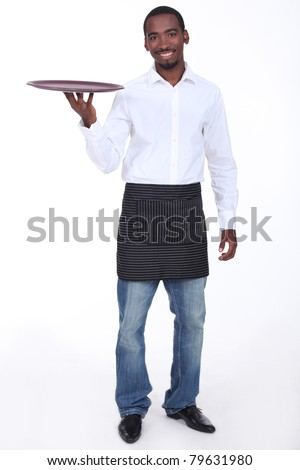 Casually dressed waiter with a drinks tray - stock photo