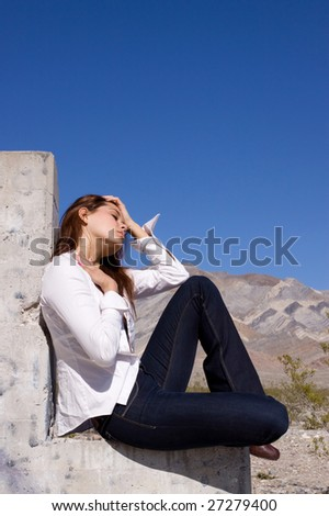 Casually dressed woman on concrete - stock photo