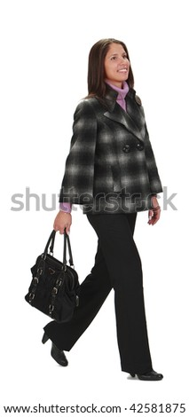 Casually dressed woman with a bag, walking,isolated against a white background. - stock photo