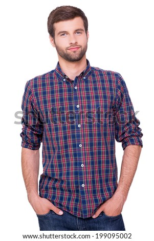 Casually handsome. Handsome young man in casual shirt holding hands in pockets  and looking at camera while standing isolated on white - stock photo