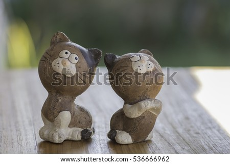 Cat Dolls Clay lovers on wooden floor