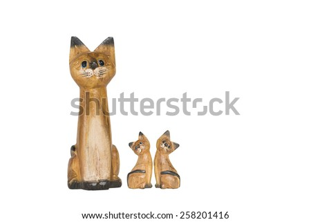 cat family, carving wood  - stock photo