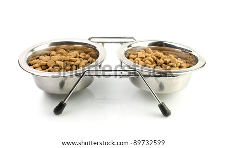 Cat food in a silver bowls  on a white background - stock photo
