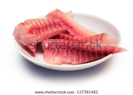 Cat food, pieces of fish on a plate for the cat as a backdrop - stock photo