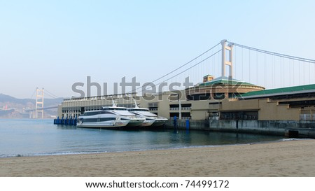 Catamaran ferry in harbor - stock photo