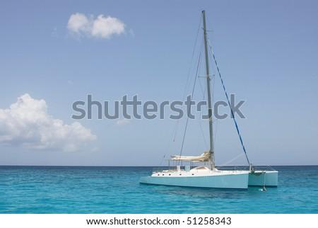 catamaran in saona beach - caribbean sea - stock photo