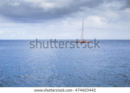 Catamaran in the bay near the coast of the city Fort-de-France, Martinique