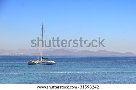 Catamaran in the sea of lanzarote - stock photo