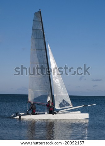 Catamaran on Baltic sea on blue sky background - stock photo