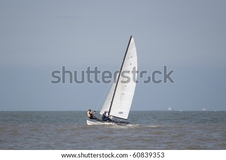 Catamaran sailing at sea - stock photo