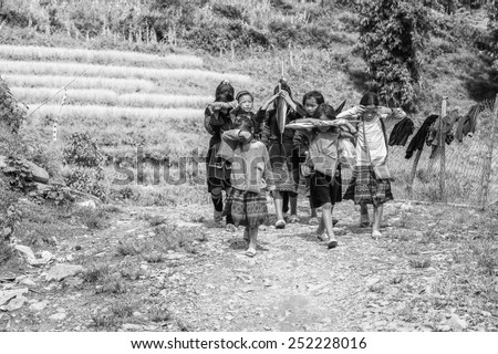 CATCAT, VIETMAN - SEP 20, 2014: Unidentified Hmong children walk and smile in Catcat village, Vietnam. Hmong is a minority ethnic group of Vietnam