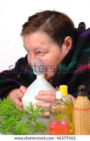 catch cold woman doctor oneself  Inhalation therapy - stock photo