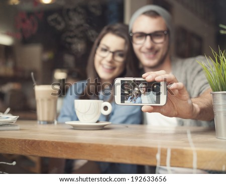 Catching memories by stylish young couple  - stock photo