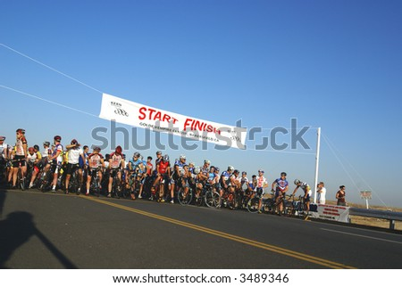 Category racers line up for start of the Golden Empire Classic bicycle race - stock photo